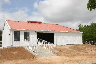 "New ""Longhouse"" completed May 2011, note cellar access for tractor lower left."