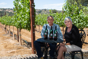Norm and I sitting in our vineyard with our award winning wines!